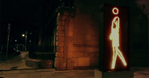 Still image from music video for SlowPlaceLikeHome's There Go The Lights Again, featuring Julian Opie's 'Suzanne walking in Leather Skirt' (2006) outside Dublin City Gallery, the Hugh Lane on Parnell Square